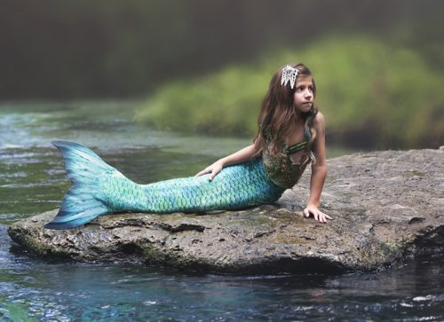 Aurora, young mermaid on rock photo
